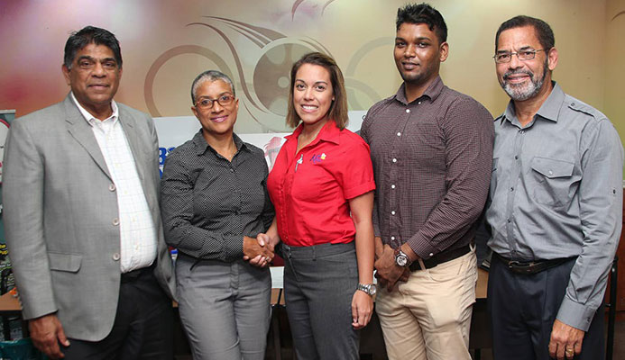 LAUNCH: From 2nd left, Dianne Henderson, chairperson of TTIM shakes hands with Kiss baking representative Sarah Jones as Diabetes Association vice president Andrew Dhanoo, Francis William Smith, director at TTIM, and at left, Tony Harford TTIM member looks on during the launch of the 2018 TT International Marathon at Olympic House, Port of Spain.