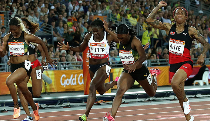 Michelle-Lee Ahye of Trinidad and Tobago celebrates as she wins gold ahead of Christania Williams of Jamaica and Asha Philip of England. Photo: Getty.