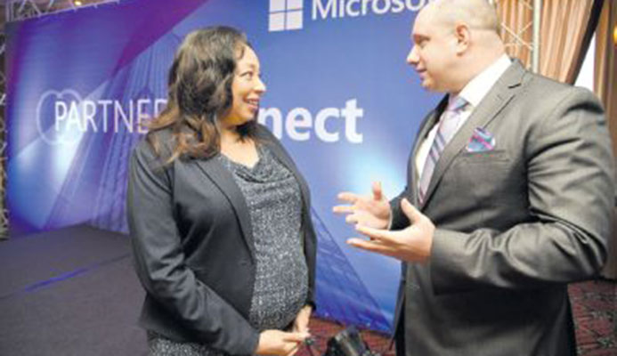 Racquel Moses, country manager, Microsoft T&T, and Herbert Lewy, general manager, Microsoft Caribbean, speak during the Microsoft Trinidad and Tobago Partner Connect at the MovieTowne Banquet and Conference Centre Port-of-Spain yesterday. PICTURE ANISTO ALVES