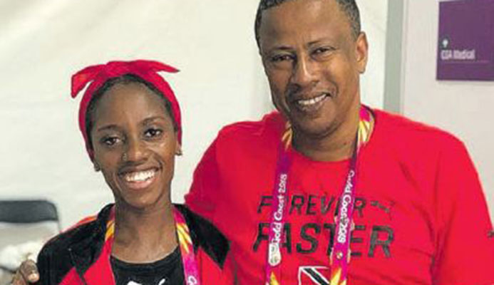 T&T's top international distance runner Tonya Nero and national distance coach Dexter Voisin after she placed 14th in the Commonwealth Games women's marathon in Gold Coast, Australia, yesterday. She clocked 2.55.14.