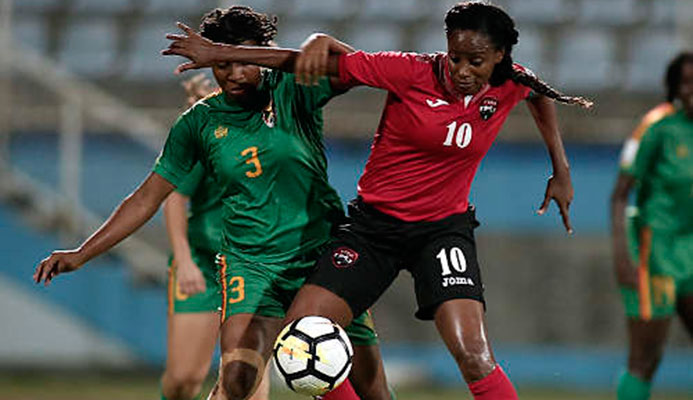 Photo: Trinidad and Tobago captain Tasha St Louis (right) holds off Grenada defender Treasher Valcin during 2019 World Cup qualifying action at the Ato Boldon Stadium on 27 May 2018. (Copyright Annalisa Caruth/Wired868)