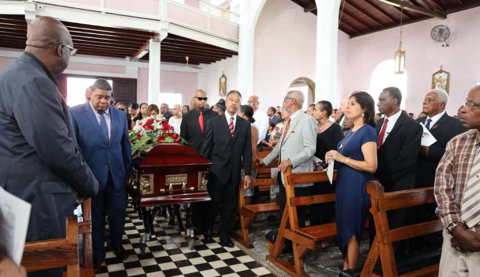 Gerard Tim Kee, left, was among the pallbearers who carried his father's casket into the church during his funeral service at St Theresa's Roman Catholic Church yesterday.