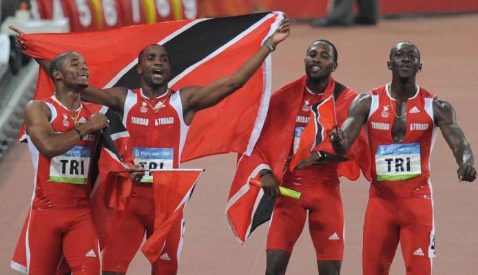 In this 2008 file photo, TT's Keston Bledman, Emmanuel Callender, Richard Thompson and Marc Burns celebrate after winning silver in the men's 4×100m relay final during the 2008 Beijing Olympic Games. AFP PHOTO -