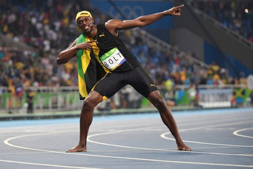 Photo: Jamaica's Usain Bolt celebrates after winning the 100 metre Olympic final for a record third successive time at the Rio 2016 Olympic Games on 14 August 2016.  (Copyright AFP 2016/Wired868)