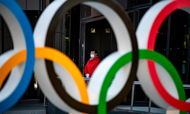 A member of staff outside the Olympic Museum in Tokyo. Photograph: Philip Fong/AFP/Getty Images
