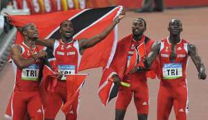 In this file photo, (from L) TT's Keston Bledman, Emmanuel Callender, Richard Thompson and Marc Burns celebrate after winning silver in the men's 4×100m relay final at the National Stadium during the 2008 Beijing Olympic Games on August 22, 2008.